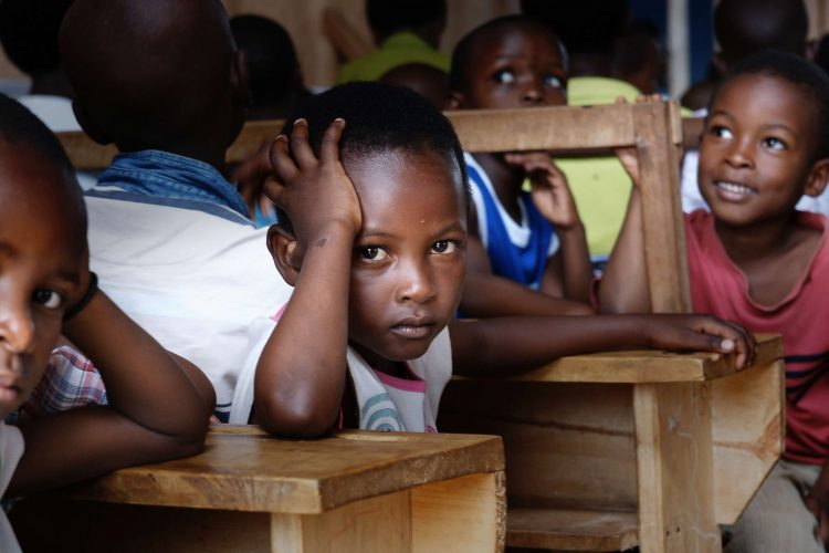 Boy Among Chidlren in Class, Looking at Camera